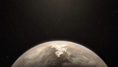Imagem artística do exoplaneta Ross 128 b, com a sua estrela, uma anã vermelha pouco ativa no topo.