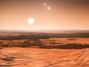 Conceção artística de uma vista à superfície do exoplaneta do exoplaneta Gliese 667Cd.